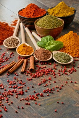 Wall mural Variety of spices on kitchen table