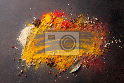Various spices on stone table