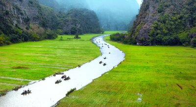 Wall mural Vietnam travel landscape. Twisted river and mountains of Tam Coc Ninh Binh