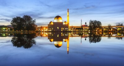 Wall mural View and reflection of Assalam Mosque blue hour. Image has grain or blurry or noise and soft focus when view at full resolution. (Shallow DOF, slight motion blur)