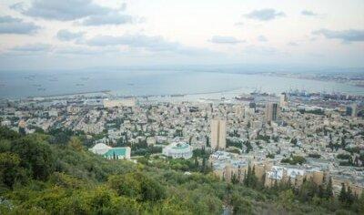 View of the bay of Haifa, the Bahai Gardens and the port at sunset. Haifa, Israel