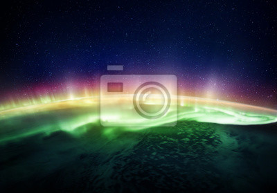 View of the planet Earth and Northern lights from space. Elements of this image furnished by NASA.