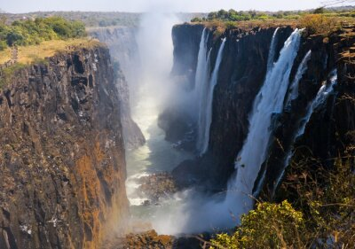 Wall mural View of Victoria Falls from the ground. Mosi-oa-Tunya National park. and World Heritage Site.  Zambiya. Zimbabwe. An excellent illustration.