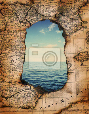 vintage burned-down map opens a view of the sea. Ready design on the subject of adventures, pirates