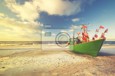 Wall mural Vintage retro stylized photo of fishing boats on the sea beach