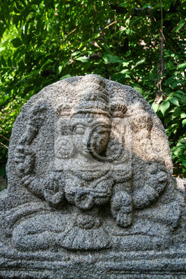 Vishnu stone statue at hampi ruins