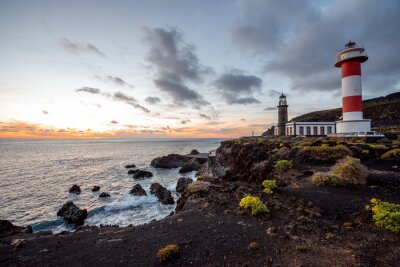 Wall mural Volcanic landscape with lighthouse near salt factory Fuencaliente on La Palma island in Spain