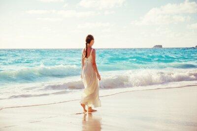 walking young woman, Seychelles beach