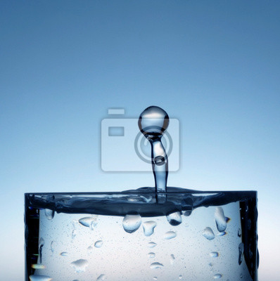 water drop falling in the cold drink