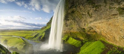 Wall mural waterfall falling from sky in Iceland