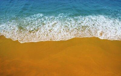 Wave of blue ocean on  beach.