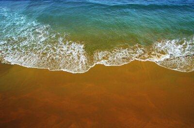 Wall mural Wave of blue ocean on  beach.