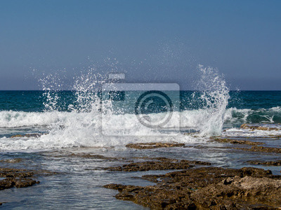 Wall mural Waves breaking on coastal rocks