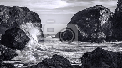 Wall mural Waves Crashing on a Rocky Coast, Black and White