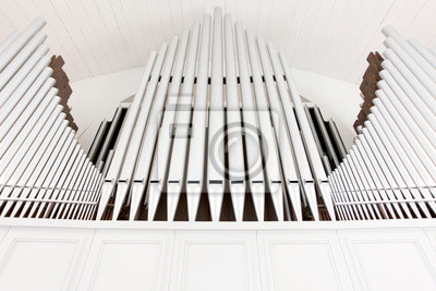 Wall mural White church organ pipes photographed from below and in symmetry
