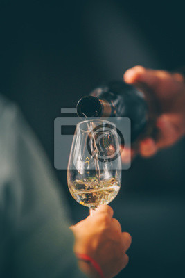 Wall mural White wine glass - Front view in wine market - close up tasting