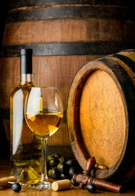 Wall mural white wine on wooden barrel background