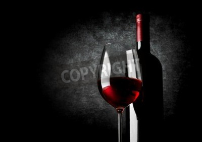 Wall mural Wineglass of red wine on a black background