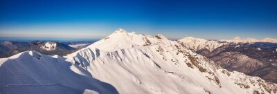 Wall mural Winter mountains panorama with ski slopes.