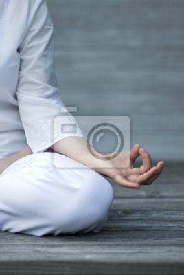 Woman doing yoga on patio. detail