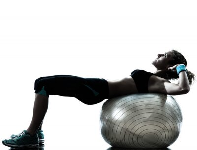 Wall mural woman exercising fitness ball workout