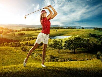 Wall mural Woman golfer hitting the ball on the  scenery  beautiful