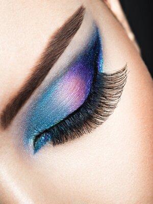 Wall mural Woman's eye with blue eye makeup