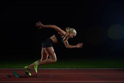 Wall mural woman  sprinter leaving starting blocks