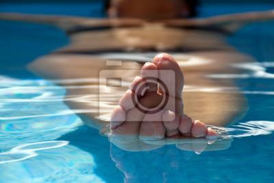 woman underwater in pool