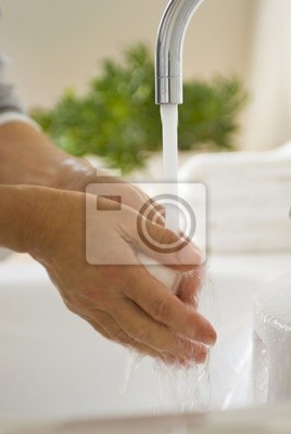 Woman washes her hands