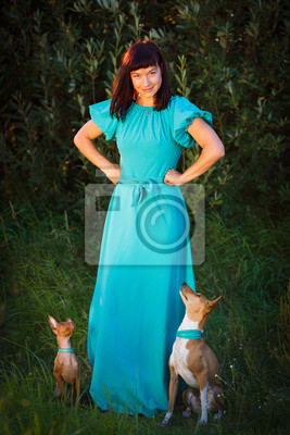 Wall mural woman with dogs