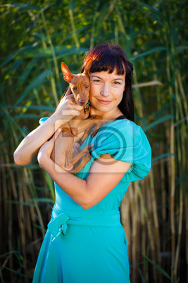 Wall mural woman with puppy