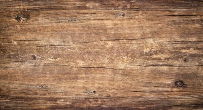 Wall mural Wood texture background. Surface of old knotted wood with nature color, texture and pattern. Top view of weathered vintage wooden table with cracks. Brown rustic rough wood for backdrop.