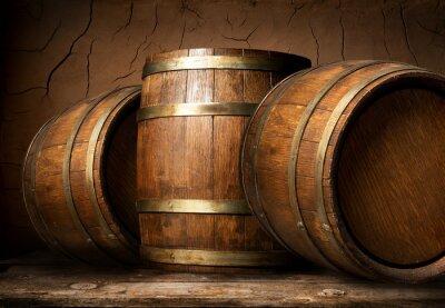 Wall mural Wooden barrels in cellar