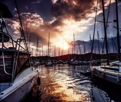 Wall mural Yacht port on dramatic sunset