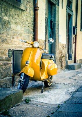 Wall mural Yellow scooter in tuscan Cortona town
