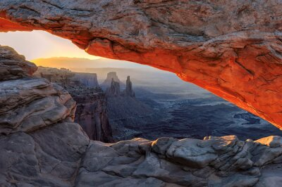 Wall mural Yellow sunrise at red Mesa Arch in Canyonlands National Park, Utah, USA