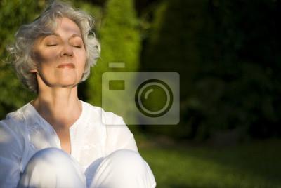 young at heart woman enjoys the evening sun