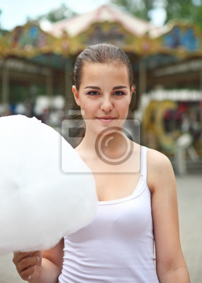 Young brunette girl near the carousel