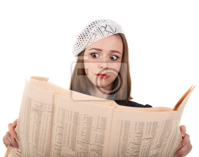 Young cute brunette girl and newspaper
