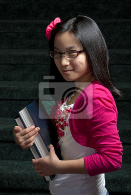 Wall mural Young girl and books