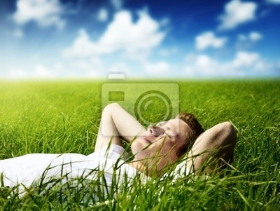 Wall mural young man in grass