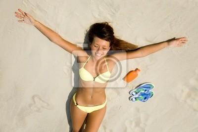 young woman in bikini sunning on the beach