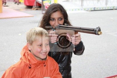 Young woman with little boy in a shooting gallery