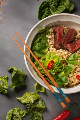 Poster A bowl of Chinese ramen noodles with beef, Chinese cabbage