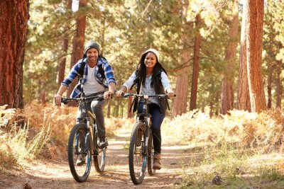 Poster African American Couple Cycling Through Fall Woodland