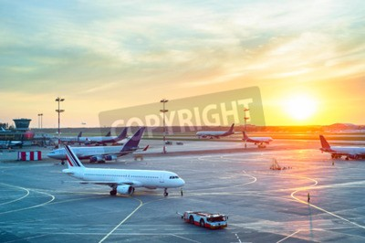 Poster Airport with many airplanes at beautiful sunset