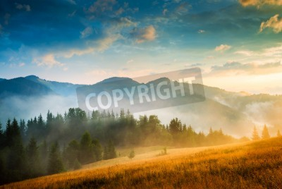 Poster Amazing mountain landscape with fog and a haystack