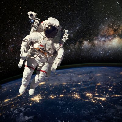 Poster Astronaut in outer space above the earth during night time. Elem