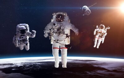 Poster Astronaut in outer space against the backdrop of the planet earth. Elements of this image furnished by NASA